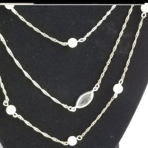 Triple strand illusion pearlesque necklace.